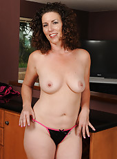 45 year old Tammy Sue posing in and out of sexy black lingerie