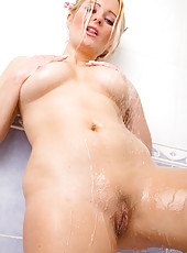 Kaz B from All Over 30 soaks down her blue teddy in the shower