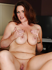 Horny redheaded Ryan slips off her elegant dress and poses nude
