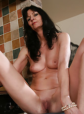 Long haired brunette MILF Scarlett D shows off her mature body