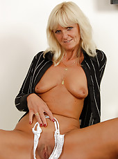 Watch 43 year old Jenny F stuff her bright white panties into her pussy