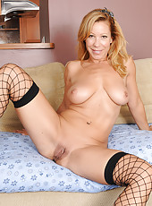 Gorgeous 45 year old Rachel posing in sexy pink lingerie and fishnets