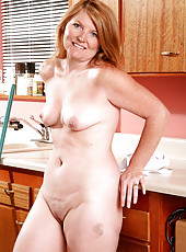 Sexy blonde haired housewife from AllOver30 stripping in the kitchen