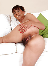 All natural and hairy MILF Gina spreads her hot bushy pussy open
