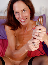 46 year old Sherry W stabs at her mature pussy with a glass dildo
