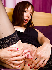 Gorgeous 43 year old Cindy slips her fingers into her puffy pussy