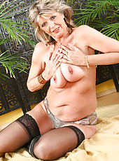Cute 50 year old grandma gets nude and fingers herself for you