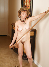 54 year old Judy strips out of her nylons and spreads her legs