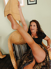 Horny 43 year old Chane plays with her pussy underneath her nylons