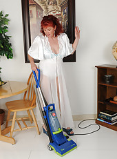 50 year old Surely from AllOver30 gets naked while doing her housework