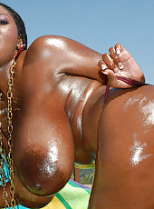 This super hot ebony huge tittied babe gets all oiled up for us so we can get a glimpse of what tripple fs look like