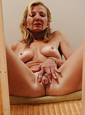 56 year old housewife Pam examining her mature pussy in a mirror