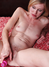 Pale MILF Tommi from AllOver30 stuffs her little pussy with pink toy