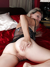 At 52 years old blonde MILF Sienna proudly displays her moist box