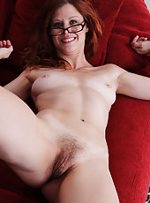 Smoking hot redheaded Jessica Adams crams a toy into her pussy