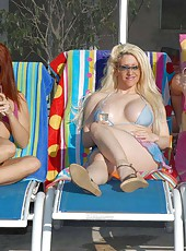 This milf pool party gets hotter than the sun when they get naked and start lubing up with the oil in these pics