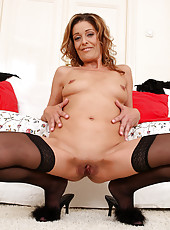 Gorgeous 39 year old Linda Cain in stockings and lace spreading pink