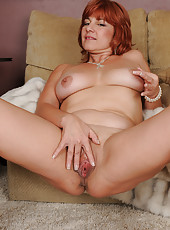 Horny 52 year old Calliste from AllOver30 playing with her lage boobs