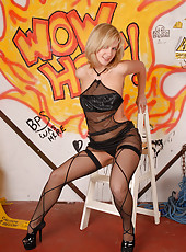 Blonde MILF hottie Laurita poses and spread in front of firey grafitti