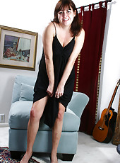 Small chested Kitty L from AllOver30 slips off her black lacey lingerie