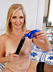 55 year old Annabelle stabs at her mature pussy with a big dildo