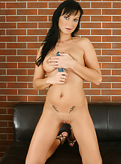 Brunette MILF Tessa strips and slides a blue dildo up her pussy