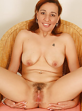 Hot Mexican MILF strutting her stuff and looking sexy in here