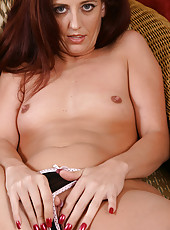 Elegant 32 year old long haired MILF fingers her swollen pussy