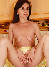 46 year old Jenny H samples some food and plays with her pussy