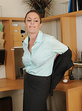 Office girl Tamara Fox puts down the telephone to tug on her pussy