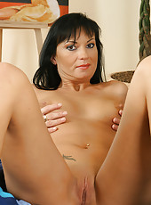 Brunette MILF in a hot orange outfit spreads her mature pussy