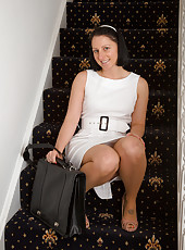 Amber L from AllOver30 stops on the stairs to toy her mature pussy