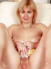 Busty blonde Nella from AllOver30 spreads her meaty pussy open