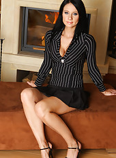 Sexy and elegant Enza from AllOver30 strips and spreads her long legs