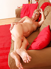 57 year old Lena F in sexy red lingerie spreads her legs on the couch