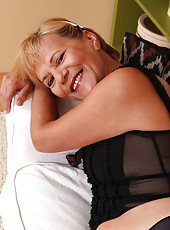 Blonde and 56 years old Lili strips off her panties to reveal natural bush