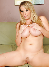 Busty blonde Maggie G stuffs her mature pussy with a large dildo