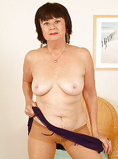 63 year old Mona strips off her clothes showing moist pussy