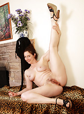All natural and hairy Artemesia strips and spreads her mature pussy
