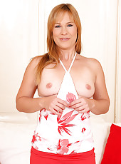 Tight and mature Laura King shows off her 30 year old pink pussy