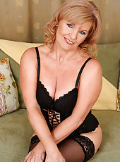 Gorgeous 57 year old Lena F slips out of her slinky lingerie to pose