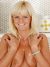 Mature housewife Jenny F from AllOver30 spreads her ass wide open