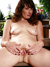 32 year old Ava from AllOver30 spreads her redheaded pussy for you