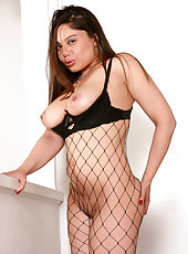 33 year old Luccia from AllOver30 wearing fishnets and spreading