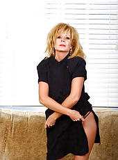 Elegant Arowyn slips off her black dress and poses in here