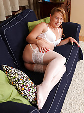 Gorgeous blonde MILF Laura King looking hot in her slinky white lace
