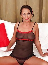 Sandy K strutting her amazing 36 year old stuff in hot black lingerie