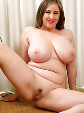 Cute MILF with the biggest tittes doing housework