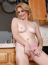 Hot blonde Ashley get nice and wet in the kitchen