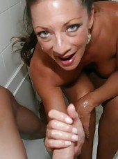 Every time her hubby is away on trip, Margo loves to give raunchy handjobs to the young stud. Spitting and dirty talking makes this boy burst buckets of cum
